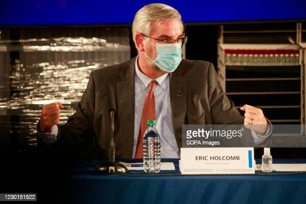 Indiana Governor Eric Holcomb wearing a face mask speaks during a round table discussion at Catalent Biologics, where COVID vaccine vials are being...