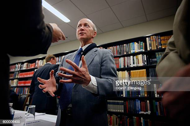 Indiana Governor Mitch Daniels chairs a meeting of the Indiana Economic Development Corporation in Winona Lake, Indiana.   Location: Winona Lake,...