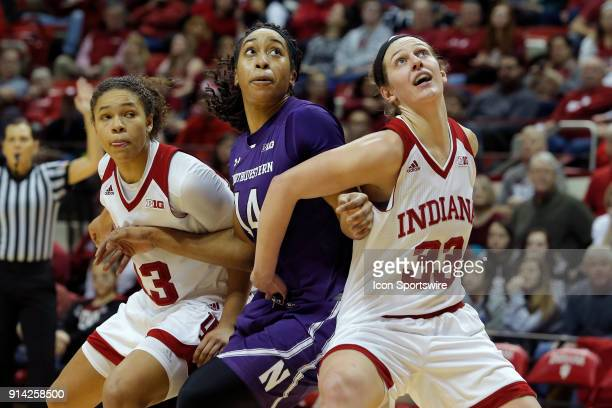 Indiana Hoosier forward Amanda Cahill blocks out Northwestern Wildcats forward Pallas KunaiyiAkpanah during the game between the Northwestern...