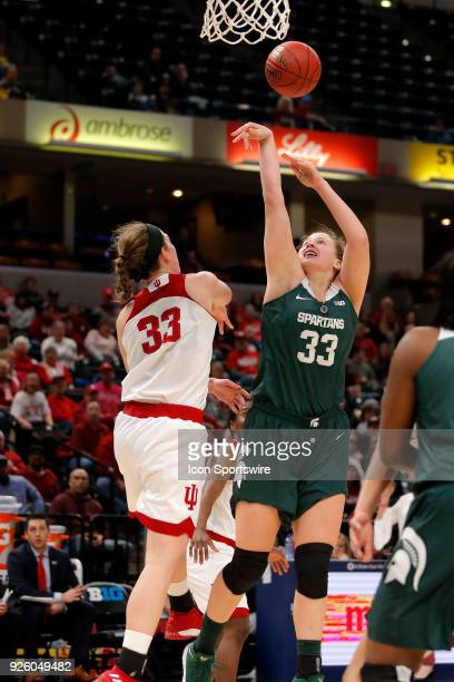 Indiana Hoosier forward Amanda Cahill blocks the shot of Michigan State Spartans center Jenna Allen during the game between the Michigan State...
