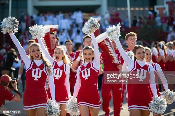 Indiana Hoosiers cheerleaders are seen before the game against the Ball State Cardinals at Memorial Stadium on September 15 2018 in Bloomington...