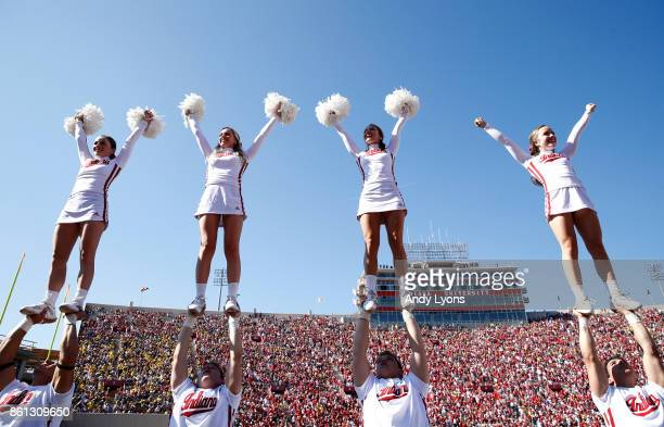 Indiana Hoosiers cheerleaders perform during the game against the Michigan Wolverines at Memorial Stadium on October 14 2017 in Bloomington Indiana