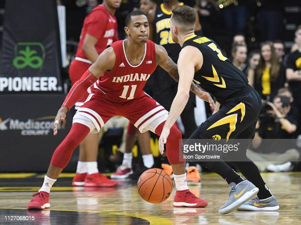 Indiana Hoosiers forward Juwan Morgan tightly guards Iowa Hawkeyes guard Jordan Bohannon during a Big Ten Conference basketball game between the...