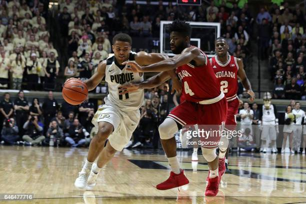 Indiana Hoosiers guard Robert Johnson guards Purdue Boilermakers guard PJ Thompson during the Big Ten conference rivalry game on February 28 at...