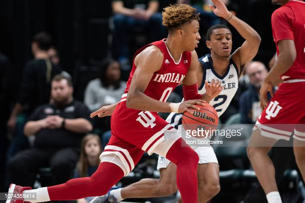 Indiana Hoosiers guard Romeo Langford drives to the lane against Butler Bulldogs guard AaronThompson during the Crossroads Classic basketball game...