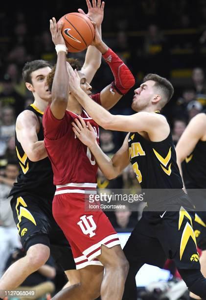 Indiana Hoosiers guard Romeo Langford is tightly guarded by Iowa Hawkeyes forward Nicholas Baer and Iowa Hawkeyes guard Jordan Bohannon during a Big...