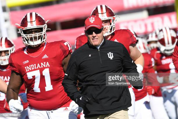 Indiana Hoosiers Head Coach Tom Allen leads his team on to the field for the start of the Big Ten conference college football game between the...