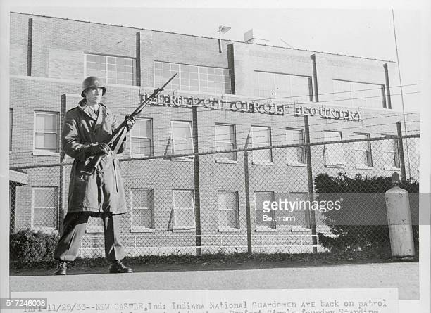 Indiana National Guardsman Cpl Kenneth Lucas of Connersville Indiana stands guard with bayonet fixed as modified martial law was clamped on the...
