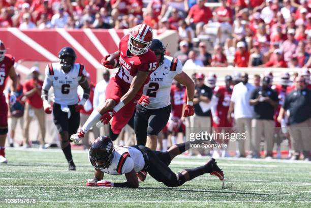 Indiana Nick Westbrook attempting to avoid a Ball State tackle by Bryce Cosby during a college football game between the Ball State Cardinals and...