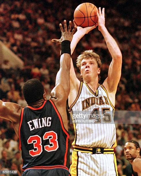 Indiana Pacers center Rik Smits shoots over New York Knicks center Patrick Ewing during first quarter play 04 April 1999 at Market Square Arena in...