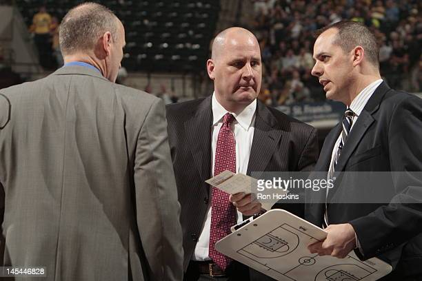 Indiana Pacers coach Frank Vogel Dan Burke and Jim Boylen talk against the Orlando Magic in Game Five of the Eastern Conference Quarterfinals during...