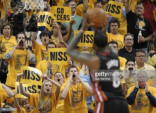 Indiana Pacers fans shout at the Miami Heat's LeBron James while he shoots free throws during the second half in Game 5 of the Eastern Conference...
