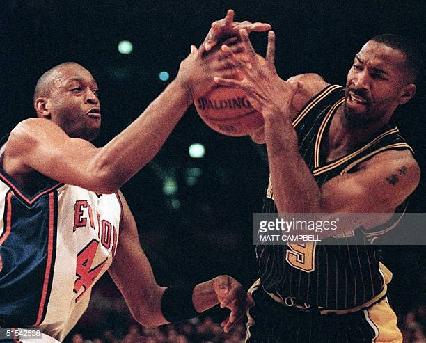 Indiana Pacers forward Derrick McKey battles with New York Knicks forward John Wallace during the second quarter 19 February 2000 at Madison Square...