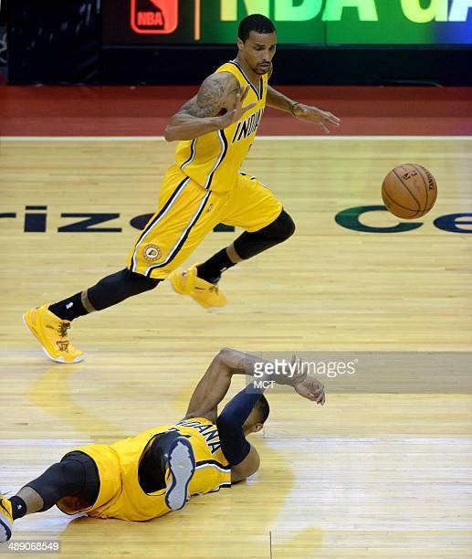 Indiana Pacers forward Paul George bottom flips a pass from on his back to Indiana Pacers guard George Hill during the third quarter against the...