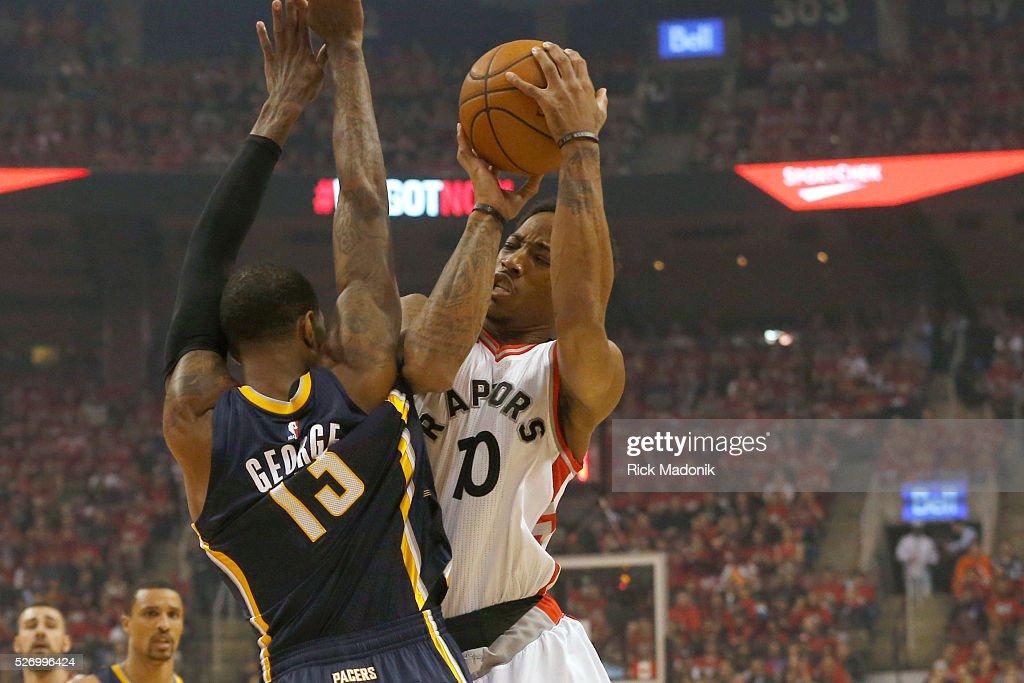 Indiana Pacers forward Paul George fouls Toronto Raptors
