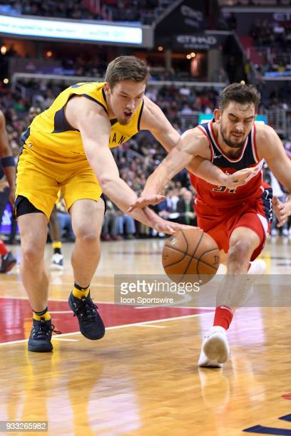 Indiana Pacers forward TJ Leaf and Washington Wizards guard Tomas Satoransky fight for a loose ball on March 17 2018 at the Capital One Arena in...