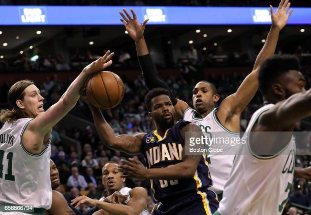 Indiana Pacers guard Aaron Brooks looks for an outlet as he is boxed in by the Celtics defense in the fourth quarter The Boston Celtics host the...