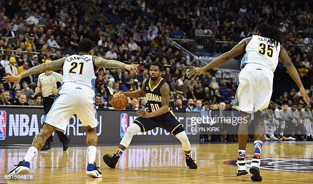 Indiana Pacers' guard Aaron Brooks sees his path blocked by Denver Nuggets' forward Wilson Chandler and Denver Nuggets' forward Kenneth Faried during...