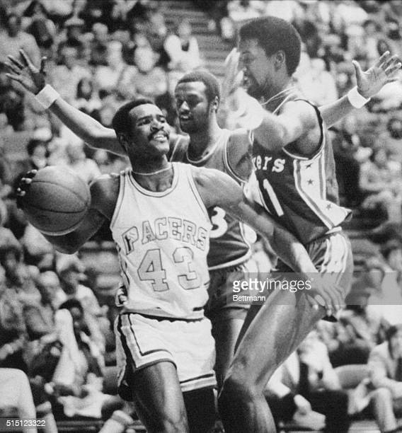 Indiana Pacers guard Earl Tatum is double teamed by 76er teammates Joe Bryant and Caldwell Jones during a game at the Market Square Arena in...