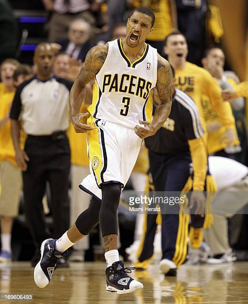 Indiana Pacers guard George Hill celebrates after scoring against the Miami Heat during the first quarter in Game 4 of the NBA Eastern Conference...