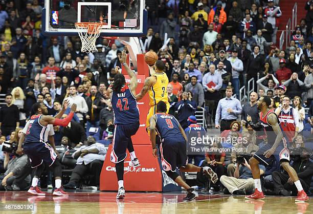 Indiana Pacers guard George Hill glides between four Washington Wizards defenders to score the game winning points for their 103101 win on March 25...
