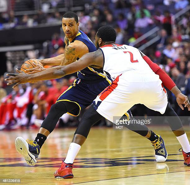 Indiana Pacers guard George Hill is defended by Washington Wizards guard John Wall during the second half of their game played at the Verizon Center...