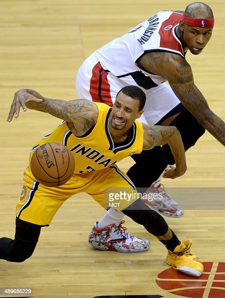 Indiana Pacers guard George Hill recovers his dribble against Washington Wizards forward Al Harrington in the first half of Game 4 of the NBA Eastern...