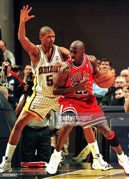 Indiana Pacers guard Jalen Rose defends as Chicago Bulls guard Michael Jordan backs toward the basket during first quarter action 17 March at Market...