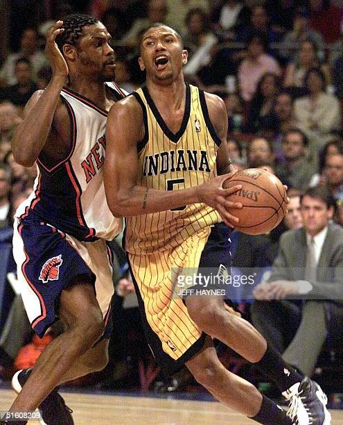 Indiana Pacers guard Jalen Rose drives past New York Knicks guard Latrell Sprewell in the second quarter 05 June 1999 in game three of the NBA...