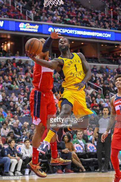 Indiana Pacers guard Lance Stephenson makes three of his game high 25 points against Washington Wizards forward Mike Scott on March 17 2018 at the...