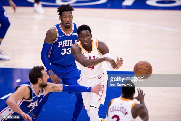 Indiana Pacers Guard Victor Oladipo makes a pass to Indiana Pacers Guard Darren Collison in the second half during the game between the Indiana...