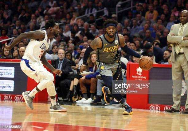 Indiana Pacers guard Wesley Matthews dribbles past Los Angeles Clippers guard Patrick Beverley during the game on March 19 at Staples Center in Los...
