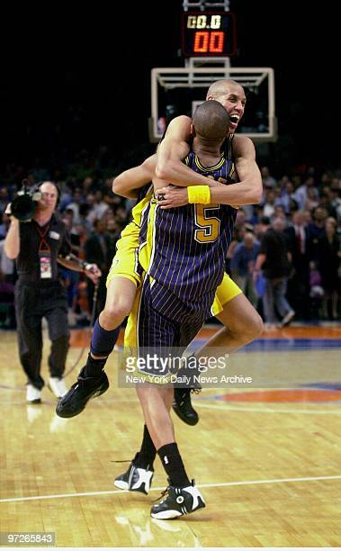 Indiana Pacers' Jalen Rose carries teammate Reggie Miller after defeating the New York Knicks 9380 in Game 6 of the Eastern Conference finals at...
