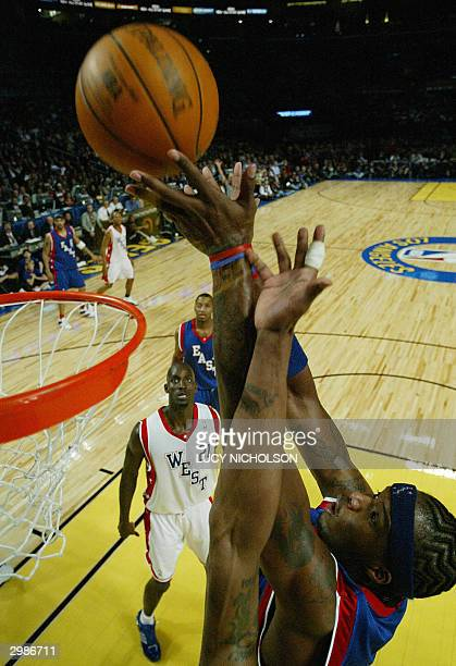 Indiana Pacers' Jermaine O'Neal of the East grabs a rebounde during the second quarter of the NBA AllStars Game in Los Angeles 15 February 2004 The...