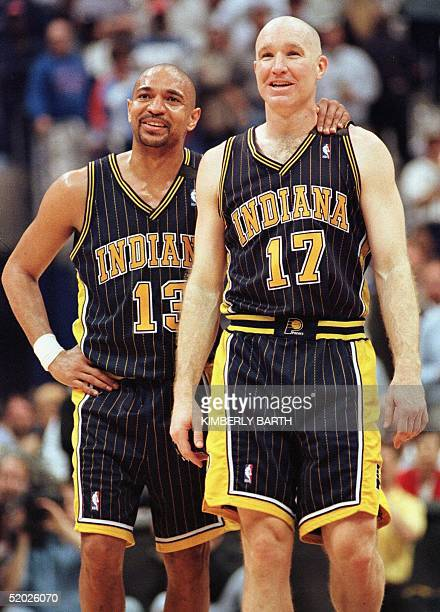 Indiana Pacers Mark Jackson and Chris Mullin smile as Reggie Miller sinks two at the foul line in the final minutes of game action against the...
