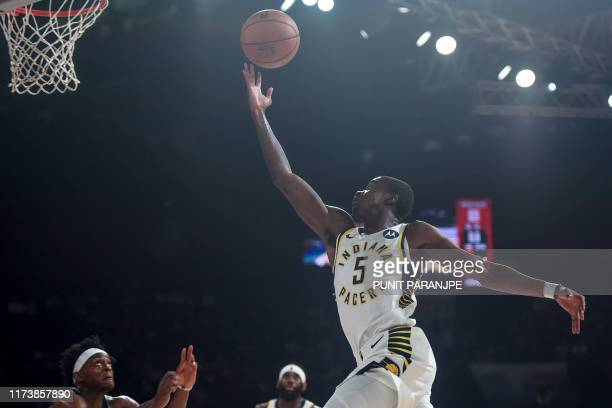 Indiana Pacers player Edmond Sumner shoots the ball during the second preseason NBA basketball game between Sacramento Kings and Indiana Pacers at...