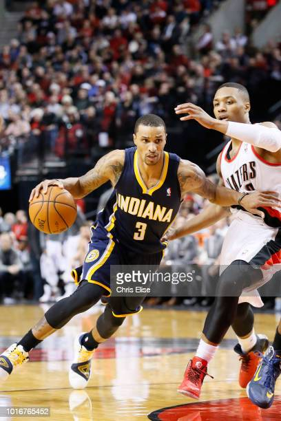 Indiana Pacers point guard George Hill drives past Portland Trail Blazers point guard Damian Lillard during the Portland Trail Blazers 106102 victory...