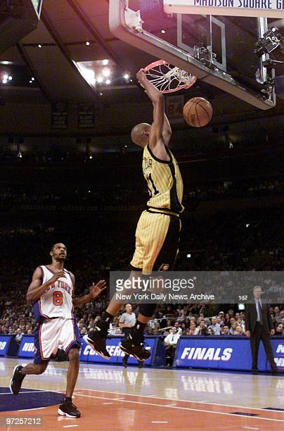 Indiana Pacers' Reggie Miller dunks as New York Knicks' Latrell Sprewell watches in Game 6 of the Eastern Conference finals at Madison Square Garden