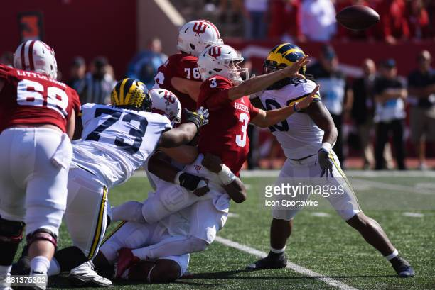 Indiana Peyton Ramsey completing a shovel pass while under pressure from Michigan Maurice Hurst and Devin Bush during a college football game between...