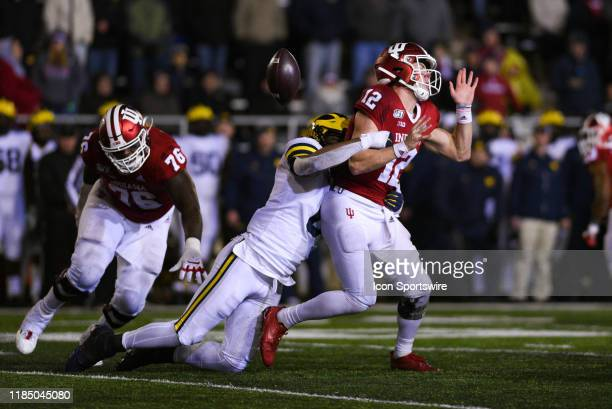 Indiana Peyton Ramsey gets sacked and the ball stripped by Michigan Josh Uche during a college football game between the Michigan Wolverines and...