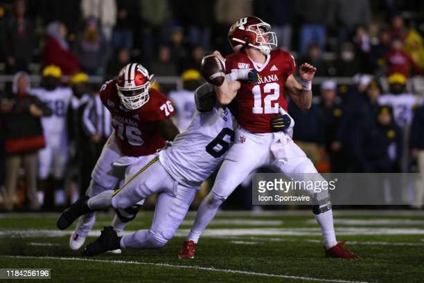 Indiana Peyton Ramsey getting sacked and losing the ball via fumble by Michigan Josh Uche during a college football game between the Michigan...