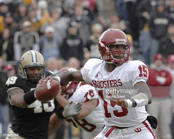 Indiana QB Kellen Lewis prepares to pass as Purdue's Anthony Spencer closes in. Purdue defeated Indiana 28-19 in Ross Ade Stadium, West Lafayette,...