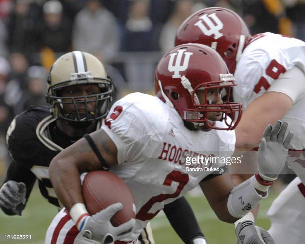 Indiana RB Marcus Thigpen runs through the line. Purdue defeated Indiana 28-19 in Ross Ade Stadium, West Lafayette, Indiana on November 18, 2006.
