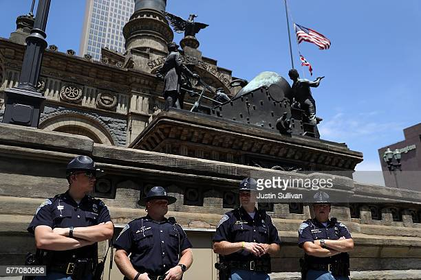 Indiana State Poice officers stand guard in Cleveland Public Square near the site of the Republican National Convention on July 18 2016 in Cleveland...