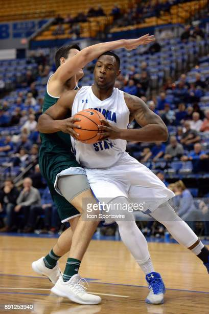 Indiana State Sycamores Center Brandon Murphy is fouled as he is going up for a lay up by Green Bay Phoenix Forward Will Chevalier during the college...