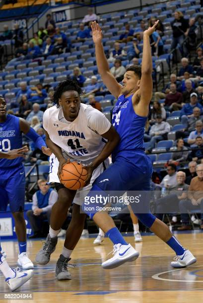 Indiana State Sycamores Center Emondre Rickman dribbles into Air Force Falcons Forward Ryan Swan during the Mountain West/Missouri Valley Challenge...