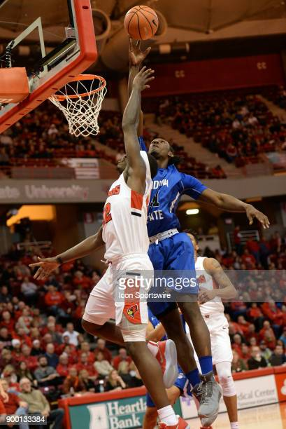 Indiana State Sycamores Center Emondre Rickman gets a hand on the shot of Illinois State University Redbirds forward Milik Yarbrough during the...