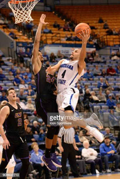 Indiana State Sycamores Guard Brenton Scott goes up for a lay up over Northern Iowa Panthers Guard Isaiah Brown during the Missouri Valley Conference...