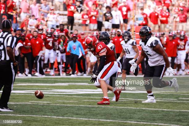 Indiana University's Micah McFadden runs to pick up the ball after the University of Cincinnati quarter back was sacked during an NCAA football game...