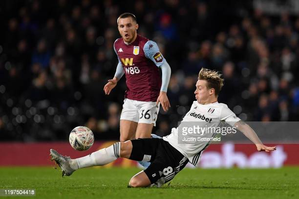 Indiana Vassilev of Aston Villa and Stefan Johansen of Fulham in action during the FA Cup Third Round match between Fulham FC and Aston Villa at...